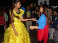 Seventh graders Lesly Aguilar and Wendy Carbajal are dancing to the music. They encouraged other students to dace as well.