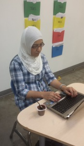 Sherish Jamshed is working on her laptop. She is staying afterschool for Guided Study to help her students on catch up on their work.