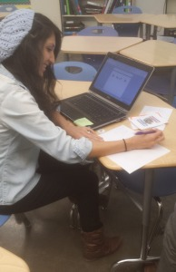 Gabriela Dampier is working on her laptop. She was staying after school to help students make flash cards, in order to study for the quiz.