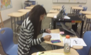 Gabriela Dampier is working. She is afterschool for Giuded Study to help students with their work.