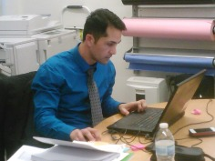 Ruben Diaz works on school report on computer