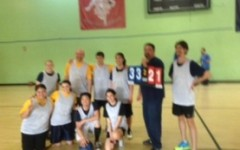 The winning team is possing in front of the cameras and showing the final score. Some of the teachers were really tired after the game.