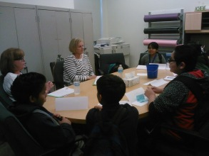 Students speaking with visitors