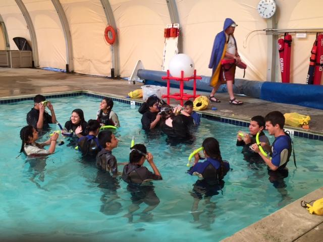 Students learning about Microgravity in the water.