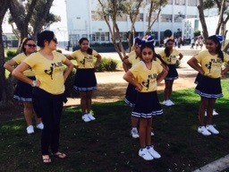 Cheer coach, Teresa Argueta, training the cheerleaders.