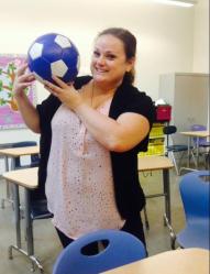 Soccer coach, Elizabeth Borum, showing her soccer ball.