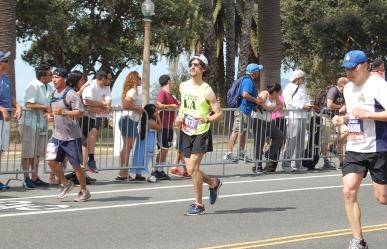 Carl Finer, SRLA coach running in the green SRLA singlet.