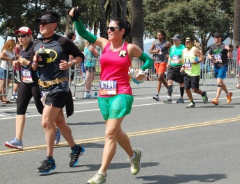 People running as Batman and Robin.