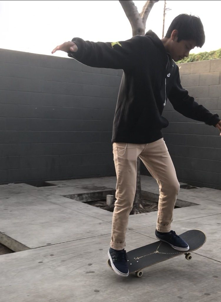 Diego Aquino, eighth grade student at AJCMS, skateboarding on campus.