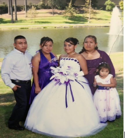 Lagunas with her four children on her daughter´s fifteenth birthday celebration.