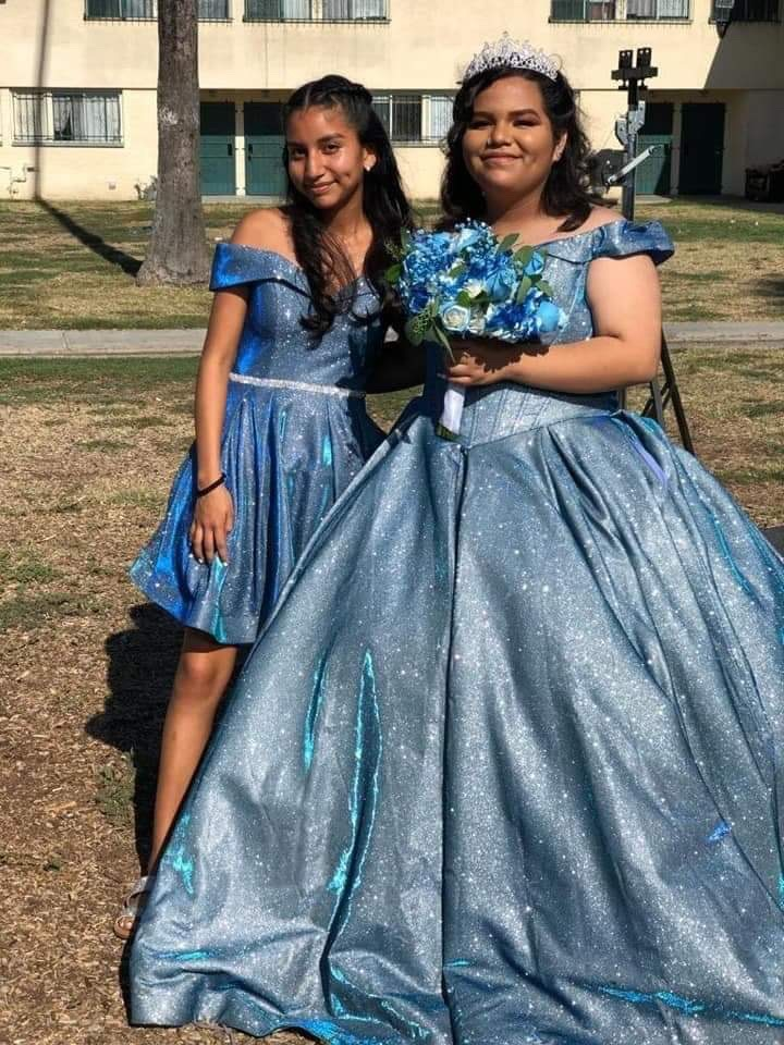 Me and my sister the day of her 15. She was so happy for it to all be happening because we have been waiting since the week before. We took pictures before she got too busy.
