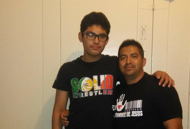 Jonathan Jimenez and Cesar Jimenez hugging