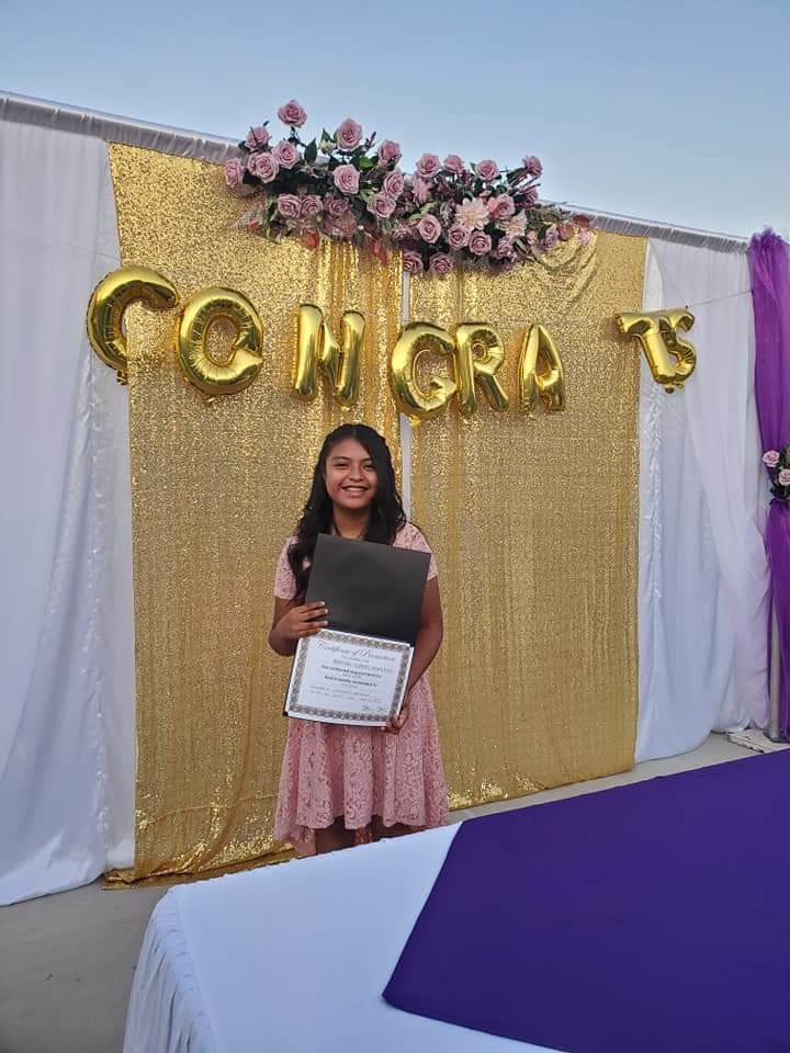 Brenda Valerio graduating from middle school.