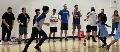 Teachers beat students in a very close basketball game