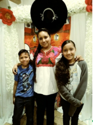 My mom,brother and me went to a party.My mom really liked the background because it was decorated with a mexico theme and it reminded her of mexico.