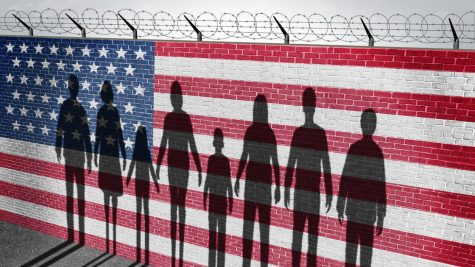 49949787 - american immigration and united states refugee crisis concept as people on a border wall with a us flag as a social issue about refugees or illegal immigrants with the cast shadow of a group of migrating women men and children.