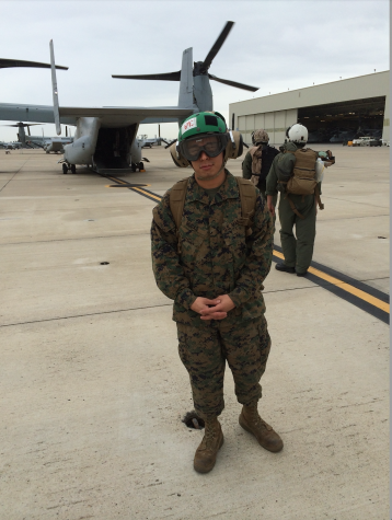This is Irvin in his gear by an Osprey. He and fellow members were heading to Yuma, AZ for pre-deployment training.