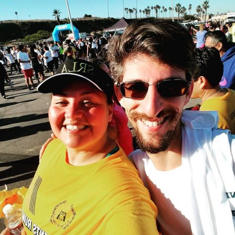 Teachers and Students Run LA coaches Carl Finer and Lorena Iglesias at the finish of the SRLA 5k at Dockweiler Beach in 2017.